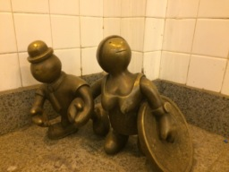 the metal midget figures of 14th Street Station in New York  (Public sculpture NYC iii)